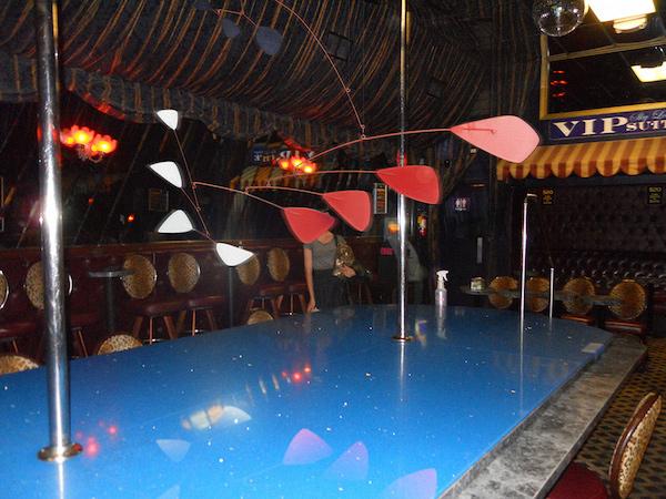 Calder in a strip club